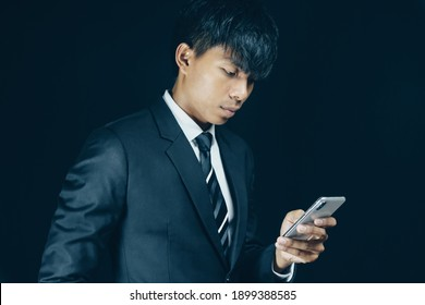 Businessman receive a lot of Money from Smartphone. Golden Bitcoin in a man hand, Digitall symbol of a new virtual currency. Crypto currency.