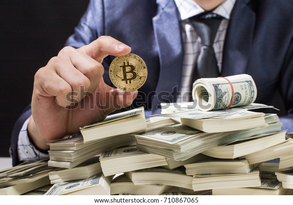 Businessman receive a lot of Money from Smartphone, Businessman Holding Bitcoin Isolated on black background, Digital Money and Bitcoine Concept.