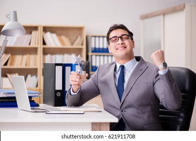 Businessman receiving award in the office