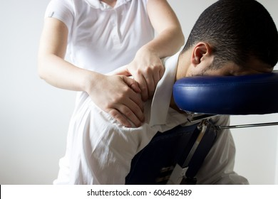 businessman receiving shiatsu on a quick massage chair