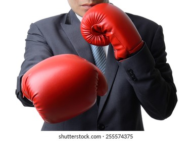 businessman with red boxing glove punch to the goal, business concept