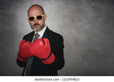 Businessman In red Boxing Gloves on gray background