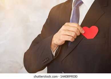 Businessman with red heart on left chest isolated on white background with clipping path.