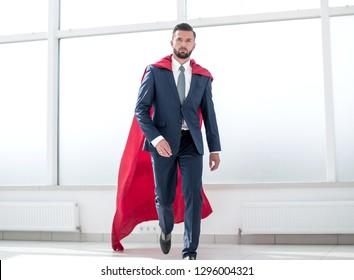 Businessman in a red superhero cloak.
