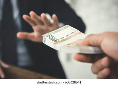 Businessman refusing money, South Korean won bills - anti bribery and corruption concepts