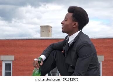 businessman relax attitude drinking bottle profile portrait outdoor terrace