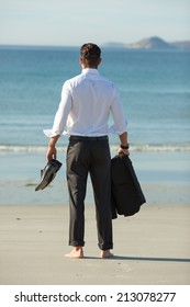 Businessman relaxing on the beach.