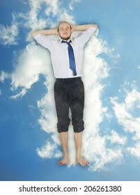 Businessman relaxing on the cloud