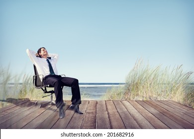 Businessman Relaxing on Office Chair at Beach