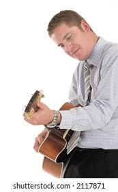 Businessman relaxing playing his old guitar over white