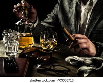 Businessman relieving stress after a hard working day drinking whiskey