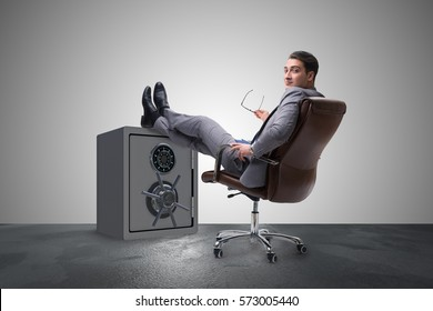 Businessman resting putting leg on safe