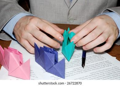 A businessman rests. Paper toys.