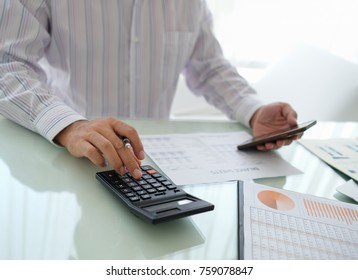 Businessman reviewing data in financial statement and assessment business. Accounting , Accountancy, Bookkeeping Concept.