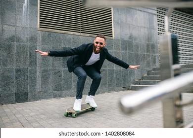 businessman ride on longboard outdoor