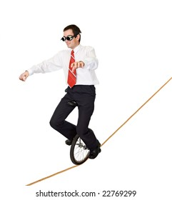 Businessman riding on mono cycle on a rope - concept for reckless business and risk taking - isolated
