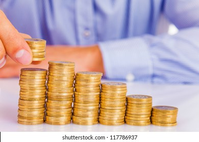 A Businessman rising coins