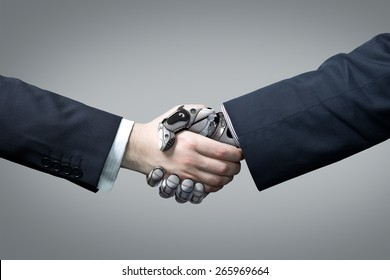 Businessman and robot's handshake. Artificial intelligence technology