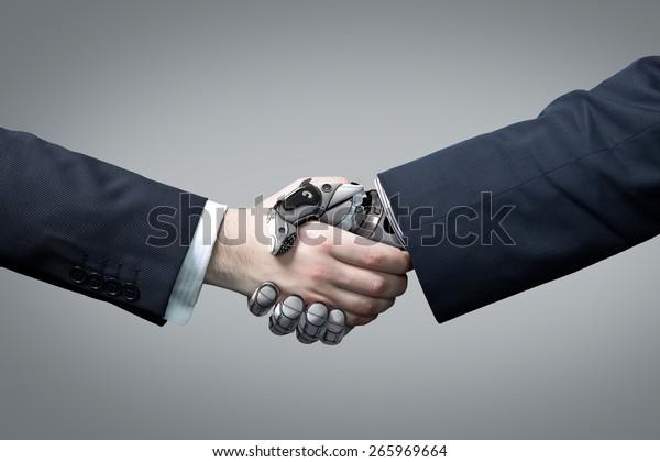 Businessman and robot's handshake. Artificial intelligence technology