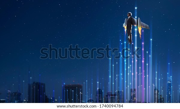 Businessman in rocket suit fly to sky with abstract dot and line lighting, online business start up boots surreal concept .