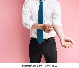 Businessman rolling up his sleeve