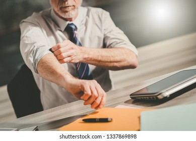 Businessman rolling up his sleeves, concept of motivation