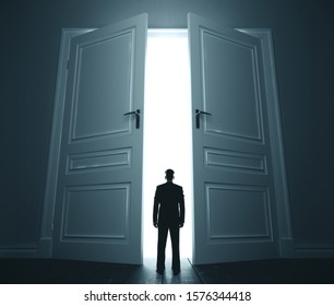 Businessman in room with open door. Motivation and startup concept.