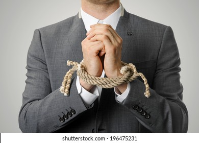 businessman with a rope tied hands