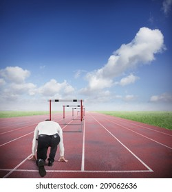 Businessman run to jumping business obstacles in a track