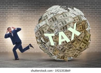 Businessman running away in tax concept