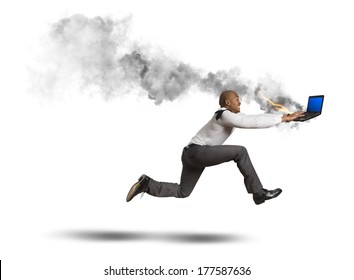 Businessman running with blue screen computer error