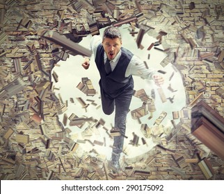 Businessman Running and Breaking Wall