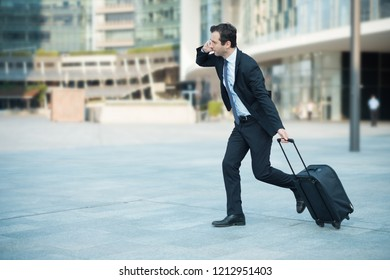 businessman running and late for his business flight