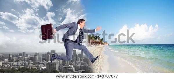 Businessman running on the beach. Summer vacation.