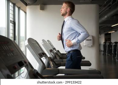 Businessman Running On Treadmill At A Health Club
