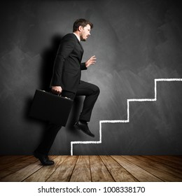 businessman running the symbolic career stairs