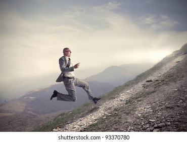 Businessman running uphill