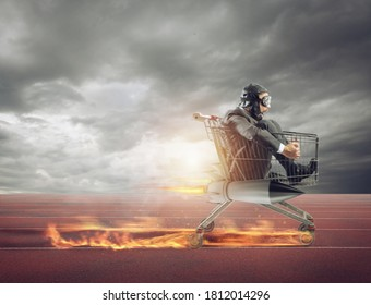 Businessman runs fast driving a cart with rocket during a competition