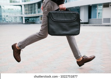 businessman rush lifestyle. man running late for work or meeting holding briefcase