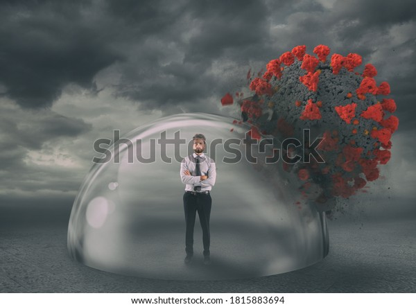 Businessman safely inside a shield dome during coronavirus pandemic. Protection and safety concept