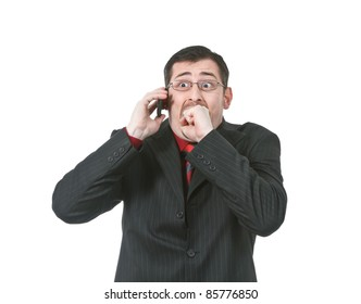 Businessman scared while talking on a cell phone