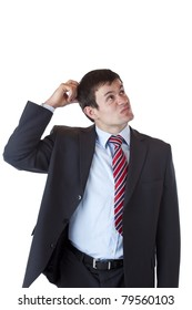 Businessman scratches his head and looks up doubtfully.Isolated on white background.