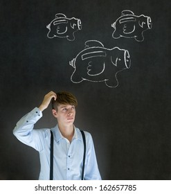 Businessman scratching head with flying money piggy banks in chalk on blackboard background