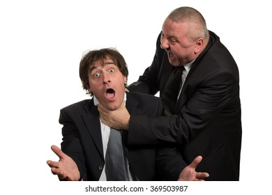 Businessman screaming and fighting at a young colleague.