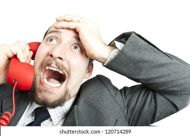 Businessman  screaming into a phone
