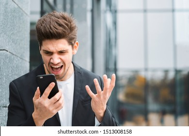 Businessman screaming on mobile phone. Having nervous breakdown at work, screaming in anger, stress management, mental distress problems, losing temper, reaction on failure