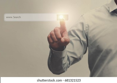 businessman search button on virtual touch screen pressed with finger, vintage soft focus picture concept