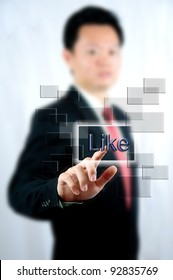 """Businessman select """"Like"""" with touch screen window"""