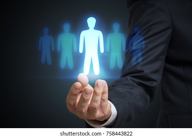 Businessman is selecting best employee candidate. Recruitment and marketing concept.