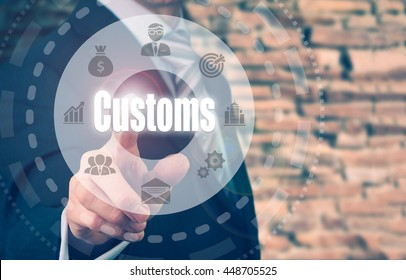 A businessman selecting a Customs Concept button on a clear screen.